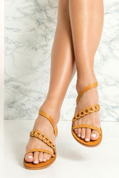 Our Daphne sandals in an amazing camel/brown color have a minimal silhouette that offers a comfortable, barely-there feel. They're handmade in Greece from fine quality waxed nubuck that wraps around the ankle, feature our signature woven strap along the instep for a secure fit. Whether on vacation or in the city, they 'll complement virtually any outfit in your summer wardrobe. They also come in silver with gold details, gold & black. Greek Chic Handmades flat sandals are handcrafted in… Greek Sandals, Open Toe Sandals, Flat Sandals, Leather Sandals Flat, Gold Leather, Summer Wardrobe, Chic, Pairs, Shoe Bag