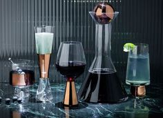 Tank Champagne Glasses are made from mouth-blown clear glass ornamented with hand-painted copper detailing. A heavy and generously proportioned glass for champa