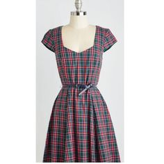 Sunny Girl Plaid Dress w/ Belt Size L NWT Modcloth Sunny Girl Plaid Dress w/ Belt Size L NWT Modcloth. Has cap sleeves and a large cutout back detail. Circle skirt makes it super cute and comfy! Plaid is red, blue, and white with a green background (liner of the dress is also green), Comes a thin, navy leather-esque belt. ModCloth Dresses Midi