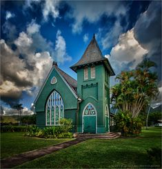 This is a quaint, picturesque chapel in the heart of Hanalei (Waioli Huiia Church) on the island of Kauai.