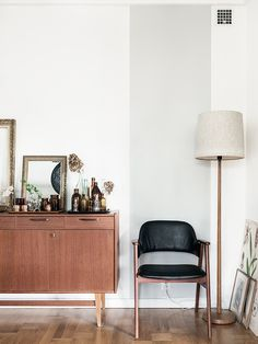 The Swedish home of a collector with mid-century touches (loving this credenza and black leather and teak chair).Stylist Johanna Flykt Gashi / Photographer Carina Olander.