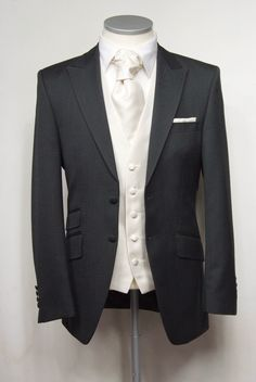 "Grey herringbone grooms lounge suit. Choose from our wide range of wedding waistcoat's in a variety of styles. Mens sizes from 32"" chest upward and include extra short, short, regular, long and extra long fittings. Boys sizes from 20"" chest to 34"" chest. Complete outfit includes jacket, trousers, hire or matching waistcoat, brand new traditional or French wing shirt in white or ivory, tie or cravat, braces and cufflinks. £125.00 to hire #groom #wedding #suit #suithire #waistcoat #grey"