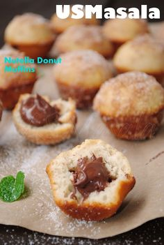 """I've come to the conclusion that I like bite-size treats..more specifically, bite-sized treats that are FILLED with something. So, behold, Nutella filled BAKED """"donut"""" mini muffins. You can replace the nutella with your faorite jam, or whatevs...either way, stuff it, bake it, pop it!"""