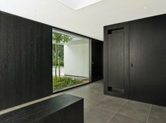 Entrance zone inside a redecorated and extended villa in Belgium by Stein van Rossem. Nice subdued color palette.