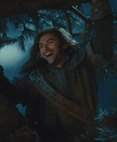 Only Kili would be smiling while climbing a tree to avoid being torn to shreds by Wargs!  XD