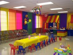Great carnival decorating ideas!  Love using the tablecloths on the walls to create a tent-like effect.