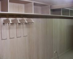 Tack room in oak with a white varnish