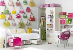 Great idea whether at home or away in a dorm room! Take a collection, like hand bags and hang them on your wall as art