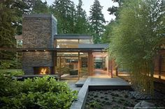 This is a perfect example of how mid-century modern homes are surrounded by and invite nature into the home.