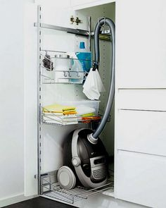 Clever roll out vacuum cleaner storage solution