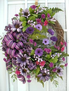 Purple springtime flowers on grapevine wreath door hanger