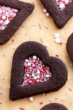 These soft Chocolate Sugar Cookies are perfect for Valentine's Day! Filled with Nutella and decorated with sprinkles, these easy heart-shaped chocolate sandwich cookies have a tender center, crisp. Valentine Desserts, Valentines Day Cookies, Valentines Day Chocolates, Valentines Day Treats, Easter Cookies, Holiday Treats, Valentines Recipes, Baby Cookies, Heart Cookies