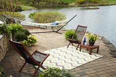 Bring whimsical style to your outdoor space with the Herringbone Ginko design. This colorful zig-zag stripe features vibrant hues of lime, teal, brown, taupe, and cream. Indoor Outdoor Rugs, Outdoor Spaces, Outdoor Living, Outdoor Decor, Outdoor Carpet, Outdoor Fun, Outdoor Ideas, Backyard Ideas, Garden Ideas
