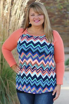 One Faith Boutique - High Expectations Colorful Chevron Raglan Top w/ Coral Sleeves ~ Size 12-18, $37.00 (http://www.onefaithboutique.com/new-arrivals/high-expectations-colorful-chevron-raglan-top-w-coral-sleeves-size-12-18/)