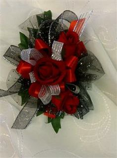 Red roses accented with silver ribbon and black netting www.countrycarriagefloral.com