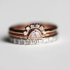 Sparkly handmade mixed metals Diamond ring set of a solitaire half moon ring, matching crown and full eternity bands.        Product details