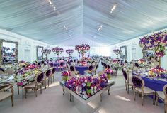 Reception Décor Inspiration From Preston Bailey | Ornate hanging mirrors and reflective tabletops amplify the striking contrast of purple and green floral arrangements in this tented reception.
