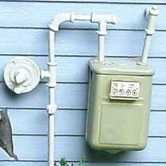 This miniature gas meter is a 1:12 scale dollhouse miniature. This gray gas…