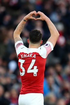 Granit Xhaka of Arsenal celebrates after scoring his team's first goal during the Premier League match between Arsenal FC and Manchester United at Emirates Stadium on March 2019 in London, United. Get premium, high resolution news photos at Getty Images Arsenal Fc Players, Arsenal Football, Arsenal Dc Comics, Arsenal Memes, Arsenal Wallpapers, Granit Xhaka, Pierre Emerick, Premier League Matches, Athletic Men