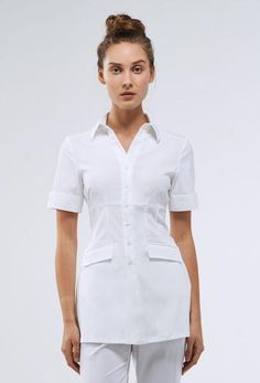 The Celina Woman's Crossover Tunic Top - The Celina Woman's Crossover Tunic Top has a crisp mandarin collar which complements this crossover top for a semi-formal fashion statement. Fastens together with an adjustable D-ring. Side slits for ease of moveme Signature Spa, Spa Uniform, Salon Uniform, Uniform Ideas, Medical Uniforms, Pull On Pants, Unisex, Fitness Fashion, Fit And Flare