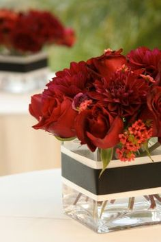Red Wedding Centerpieces.  Flowers of Charlotte loves this! Find us at www.charlotteweddingflorist.com.