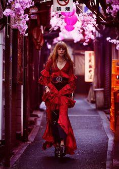 Embracing ruffles, Clara Raddatz models Romance Was Born gown, IRO belt, Gucci platforms and Ellery cropped flares