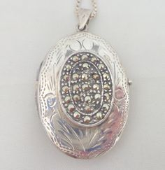 Vintage Sterling Silver Double Sided Marcasite & Etched Locket from riverroadcollectibles on Ruby Lane