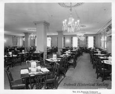 Black and white photographic print of a restaurant interior at the J.L. Hudson Company Department Store