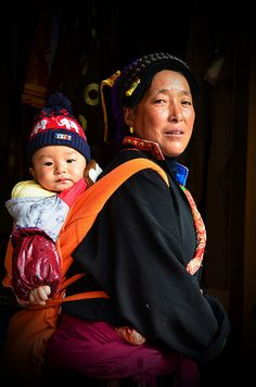 Asia | Portrait of a Tibetan mother carrying her child, Heishui County, Tibet | © Jenny Hooi #babywearing