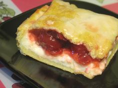Cherry danish bars: perfect for breakfast, brunch, or dessert! Made with refrigerated crescent roll dough sheets, sweetened cream cheese, and cherry pie filling. Super easy and mouth-watering! | Living the Country Life | http://www.livingthecountrylife.com/blogs/lisas-kitchen/2010/07/22/cherry-danish-bars/