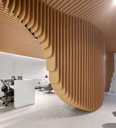 Dental Clinic in Sydney Built Around a Sculptural Wooden Installation - http://freshome.com/dental-clinic-in-sydney-built-around-a-sculptural-wooden-installation/