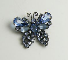 """Weiss Blue Glass and Rhinestone Butterfly Brooch. Set in a gun metal finish. Measures 1 1/4"""" in diameter. Very good condition."""