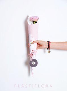 Flower + decorative paper + raffia + florist foil :).