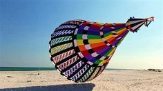 A large elaborate and colorful spinner. Anchored to the flying line of a rather large kite no doubt. T.P. (my-best-kite.com) Kite Surf, Go Fly A Kite, Kite Flying, Wind Sculptures, Children's Toys, Sea Art, Beach Walk, Outdoor Fun, Fun Stuff