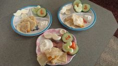 Cheese quesadilla and sour cream for dipping, frozen yogurt mustaches & buttons, cucumbers cut into mickey mouse and slices with initial cut out and carrot initial.