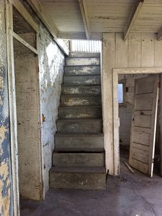 Stairwell inside an abandoned house in Chapman, Kentucky, USA ~ by redvioletblue @ flickr
