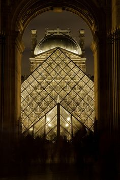 Louvre at night, Paris... I remember listening to a man on a saxophone paying in this corridor as we walk through to get into the courtyard of The Louvre... we were walking back to our hotel room at midnight. Time seems to stand still in Paris