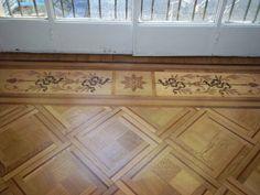 Excellent hardwood floor border inlay pattern. Installed with parquet panels.