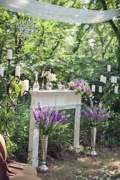 Garden/ Forest Wedding ~ alters dont have to be traditional. Bring the indoors outside with fireplaces, tables and chairs....