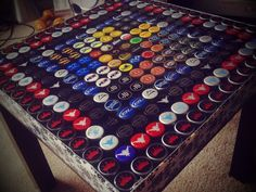 How to make a table top out of bottle caps. You can do this with anything to fit a theme (not just bottle caps)!