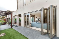 Boutique aluminium bifold doors are a great choice to create a unique feature in any style of home, making a bold statement both visually and functionally. Alfresco Area, Aluminium Windows, Interior Styling, Interior Design, Windows And Doors, Door Handles, House Plans, New Homes, House Styles