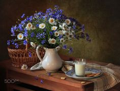 With cornflowers and daisies - null