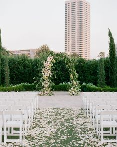 Gardening Roses The ceremony took place in a private garden. Ivory and blush sweetheart rose petals were scattered across the aisle, and an arched arbor decorated with greenery and garden roses anchored the space. Wedding Arch Greenery, Simple Wedding Arch, Wedding Arch Rustic, Wedding Mandap, Wedding Ceremony, Wedding Arches, Wedding Venues, Wedding Decor, Wedding Flowers