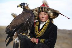 Eagle hunting, one of the most dramatic and primal relationships between man and beast, is alive and well in the Altai Mountains which run from Siberia in Russia down to Mongolia's Gobi Desert. One of the world's last true wildernesses. Eagle hunting is one of the endangered cultural traditions in the world today listed by UNESCO as a living cultural heritage in 2010.  There are only about 70 traditional eagle hunters left in the world.  This young girl (Aisholpan) is one of them.