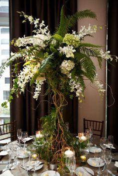 Lush Tall Garden Centerpiece with Green Foliage and White Flowers – shared on Style Me Pretty mountain wedding fall, mountain wedding decor, mountain themed Fern Centerpiece, Flower Centerpieces, Table Centerpieces, Wedding Centerpieces, Wedding Table, Rustic Wedding, Wedding Ceremony, Wedding Decorations, Table Decorations