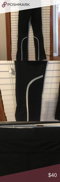 Lululemon running pant size 6 Lululemon running pant, front all black, back has reflective piping detail and striped up leg, drawstring waist, mesh along waistband, boot leg  great condition lululemon athletica Pants Boot Cut & Flare