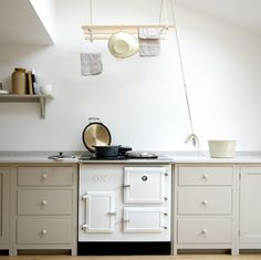 The 'Esse' range cooker makes a lovely focal point to this deVOL Kitchen with our beautifully practical laundry maid suspended above.