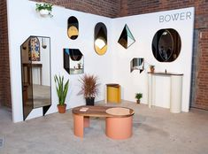 The year-old, Brooklyn-based studio Bower created a stunner of a booth, showing off their tinted Shape Mirrors — which debuted at this year's Arch Digest Home Design Show — as well as their beautiful new Moire and Contour tables, which they were finishing in the days up to the show.