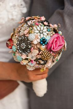 wedding headpieces with vintage brooches | For decor, it's all about glitz and glam — chandeliers, sparkling ...