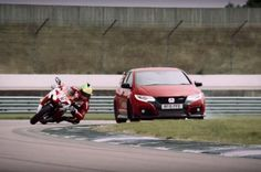 Watch the Honda Civic Type R Battle a Honda CBR1000RR Superbike Which Honda is faster around the track?